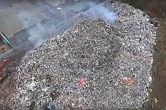 Началась ликвидация огромной горы мусора на Белокаменном шоссе